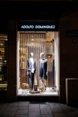 STRASBOURG, FRANCE - December 23, 2017: Adolfo Dominguez fashion shopping store window at night with male female mannequins wearing fashion luxury clothes