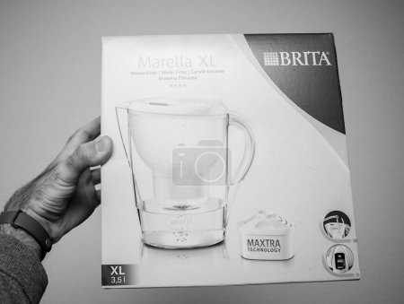 PARIS, FRANCE - December 18, 2017: Man holding New Brita Marella XL water filter against white background - black and white image