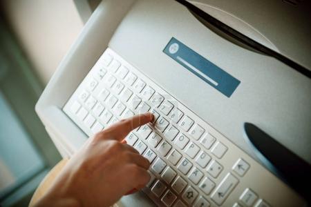 Using modern ATM keyboard  press T letter