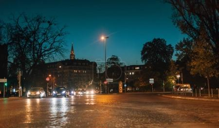 Strasbourg busy intersection with cars driving at dusk evening w