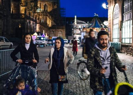 Young muslim family walking at night a day before the official i
