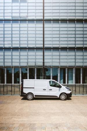 Photo for White delivery service wan parked in front of modern office industrial warehouse factory building - Royalty Free Image