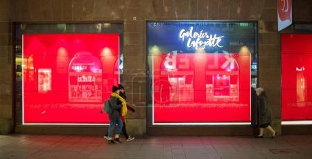 STRASBOURG, FRANCE - September 31, 2017: Galeries Lafayette fashion store in France with closed store-windows during the preparation of the Christmas edition Spectacular