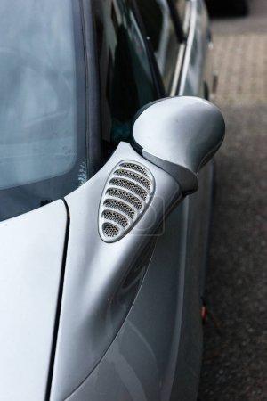 Car detail - rear view mirror of a silver car