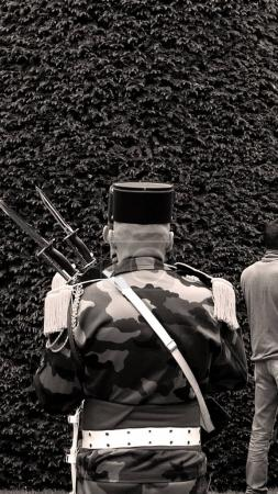 Rear view of unrecognizable solider at Ceremony to...