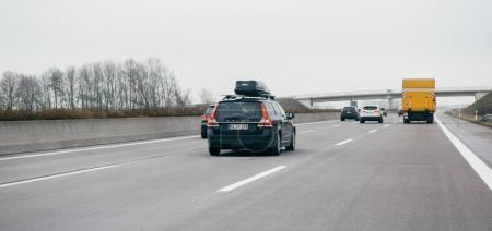 Volvo V70 D4 and other cars on the autobahn highway