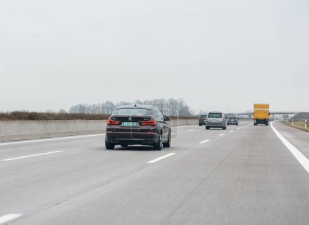 driving BMW 535i GT luxury car on the autobahn highway