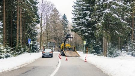 Tow truck working on German road during winter frost snow