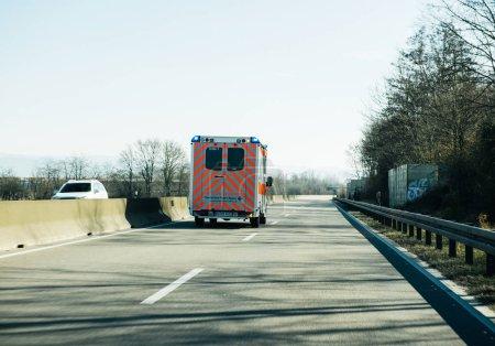 Deutsches Rotes Kreuz ambulance on German rural road