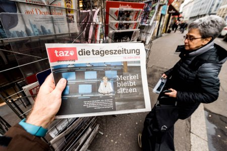 die tageszeitung Newspaper at press kiosk featuring Angela Dorot