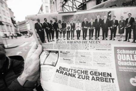 Newspaper at press kiosk featuring Angela Dorothea Merkel re ele