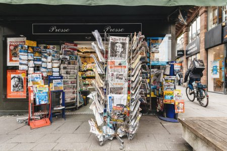 Newspapers for sale at French kiosk on a Paris street