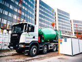 Cement mixer truck Scania on construction site
