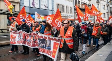 Confederation generale du travail workes with red banner placard