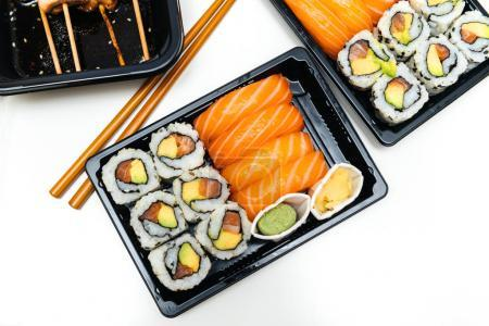 Home delivery plastic box from Japanese restaurant containing su