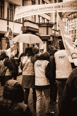 Photo for STRASBOURG, FRANCE  - MAR 22, 2018: Black and white image of SNCF train worker in France demonstration protest against Macron French government string of reforms, mutiple trade unions called publi - Royalty Free Image