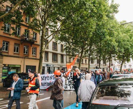 Photo for STRASBOURG, FRANCE - SEP 12, 2018: Crowd on street during a French Nationwide day of protest against labor reform proposed by Emmanuel Macron Government - Royalty Free Image