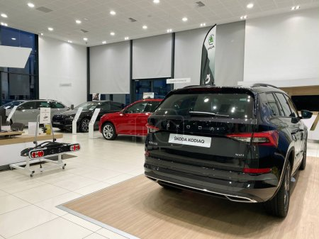 Photo for Paris, France - Oct 25, 2019: Wide angle view of car dealership showroom interior with multiple Skoda Cars inside and focus on black Skoda Kodiaq 4x4 SUV - Royalty Free Image