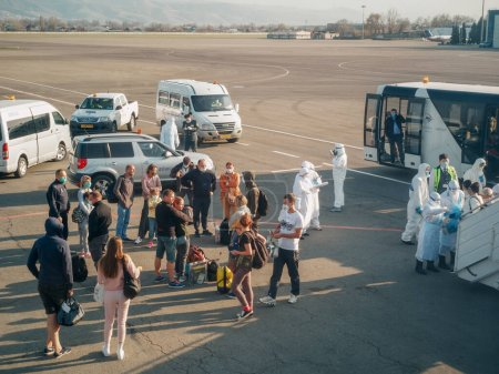 Photo for ALMATY, KAZAKHSTAN - 29 MARCH 2020.  A medical and customs control team meets a repatriation flight with passengers from coronavirus-infected countries for quarantine.  Almaty airport. - Royalty Free Image