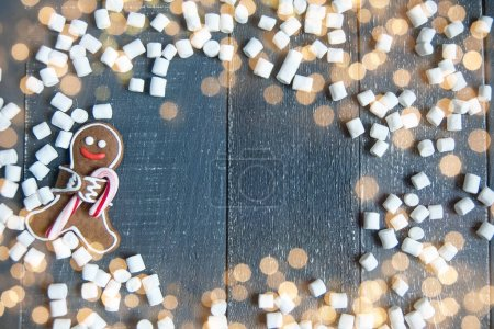 Gingerbread man with candy cane and marshmallows