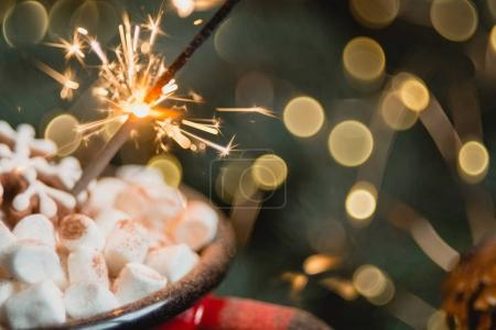 marshmallows in red cup with sparkler.