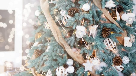 Photo for Decorated Christmas tree with eco wooden decorations on blurred and sparkling background, Happy New Year and Xmas greeting card - Royalty Free Image