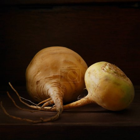 close-up of turnip on a wooden dark background