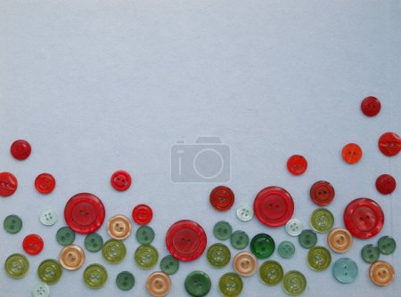 Composition with different colorful buttons on grey surface