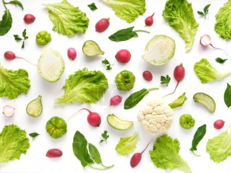 Photo for Food composition with radishes, cucumbers, cauliflowers, sorrels, salad leaves and peppers isolated on white background - Royalty Free Image