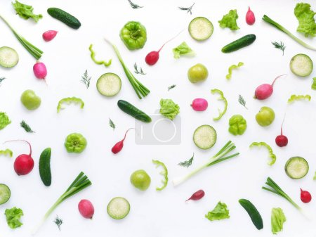 Photo for Food composition with radishes, zucchini, cucumbers, green onions, peppers, apples and dill isolated on white background - Royalty Free Image
