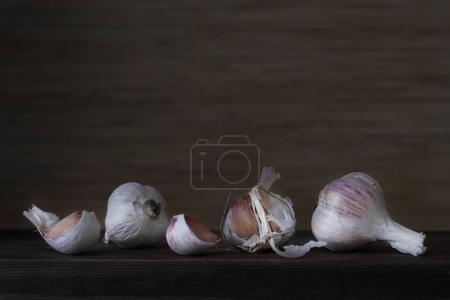 Dry garlic on a wooden dark background