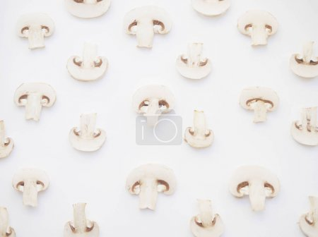 Food composition with mushroom slices isolated on white background
