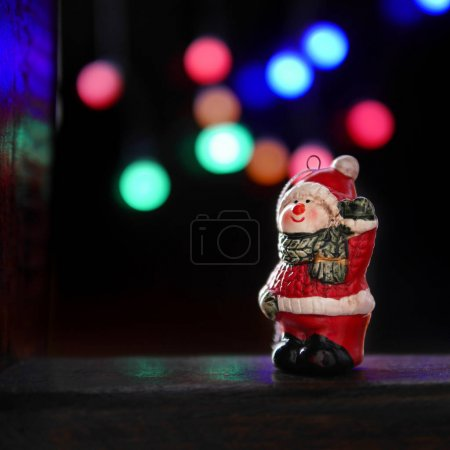 snowman Christmas-tree decoration on blurred background
