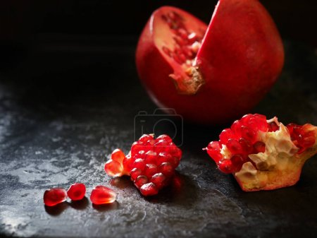 Cuted red pomegranate on stone surface