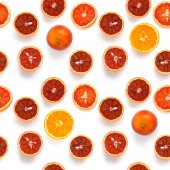 Pattern of cut oranges and blood oranges with different shades isolated on white