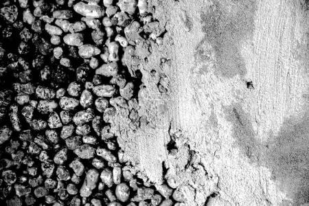 Background of gray expanded clay stones and concrete