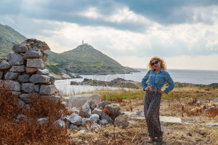 Blonde woman inside the ruins of knidos, Datca, Turkey