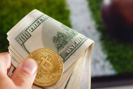 Golden bitcoin coin dollar against digital currency sport, ball