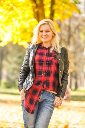 Photo for Girl walks in the autumn park - Royalty Free Image