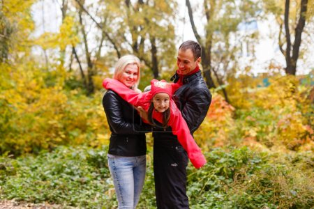 Photo for Mother and daughter in autumn park - Royalty Free Image
