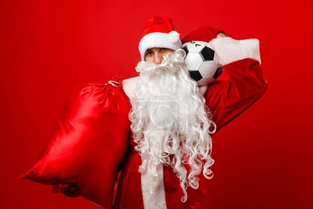 Photo for Young sexy blonde with santa claus - Royalty Free Image
