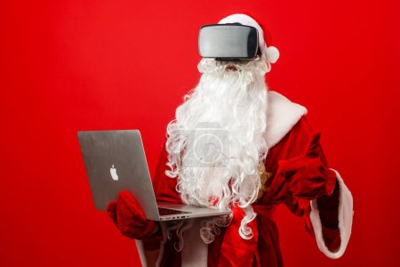 Photo for Santa claus with laptop and credit card - Royalty Free Image