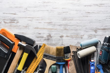 Photo for Variety of repair tools on wooden surface. Instruments on wooden table - Royalty Free Image
