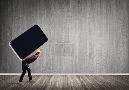 Builder man carry huge smartphone
