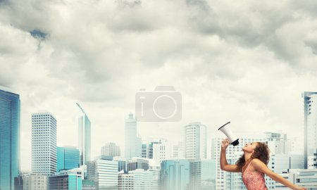 Photo for Young woman shouting in megaphone. Girl making announcement - Royalty Free Image
