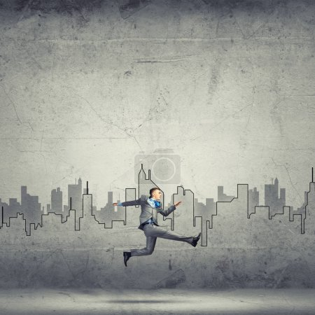 Businessman jumping high