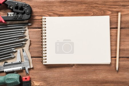 Photo for Variety of repair tools on wooden surface and place for text. Instruments on wooden table - Royalty Free Image