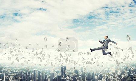Businessman jumping high
