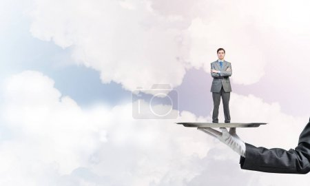 Businessman standing on tray