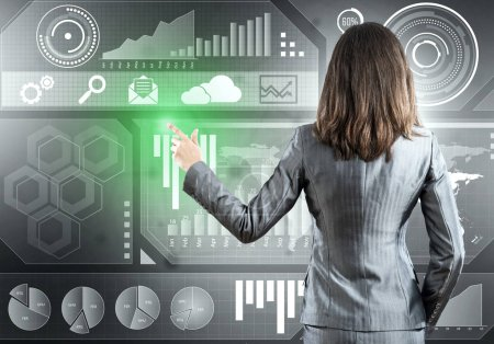 Businesswoman working with virtual panel interface